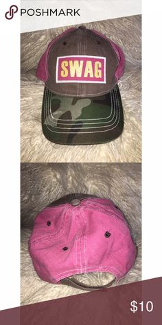 SWAG Camouflage Hat SWAG camo hat. Camo bill, olive green background where the word swag appears. Back of hat is a raspberry color. Please ask any and all questions prior to purchase. Accessories Hats