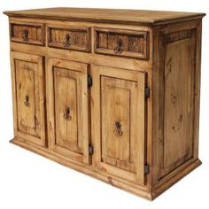 Three cabinets and three drawers provide you with extra storage space in a beautiful and very affordable southwestern credenza.  It can be placed along a wall in any room or entry area.  Put a lamp on top to brighten up a dark corner.  Mexican craftsmen have made this lovely rustic credenza by hand of solid pine.  Don't miss out on this super sale!