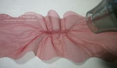Using heat gun in center of tulle ribbon to create a ruffle. From Song of my Heart Stampers.