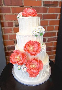 Rustic butter cream wedding cake tiered with peonies