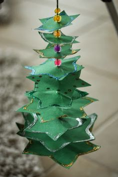 Creative Paper Tree - wonderful for a Christmas table decoration. Make them in all sizes - create a forest. Repinned by www.mygrowingtraditions.com
