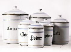 VERY LARGE French set of six WHITE and blue enamel canisters with beautiful blue and gold stripes. $250.00, via Etsy.