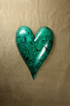Wood carving of a green wood heart by TreeWizWoodCarvings on Etsy