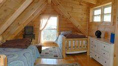 Tryon Log Cabin Home Bedroom designed by Blue Ridge Log Cabins for High Rock Rentals #highrockrentals #loghome #logcabins #cabins #bedroomdesign