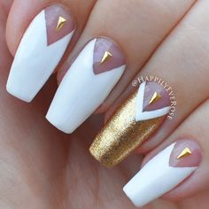 Upscale white chevron manicure gets even more glamorous with a ritzy gold nail accent plus triangle studs. Recreate this ultra posh design by grabbing onto the essentials here.