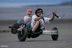 View of a competitor steering a kite buggy being pulled by a... #westonsubedge: View of a competitor steering a kite buggy… #westonsubedge