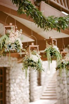Hanging centrepieces There's no need to keep your floral arrangements confined to the table – give your guests a jungle-like experience with suspended centrepieces. Birdcages, lanterns, and lush greenery all look magical.