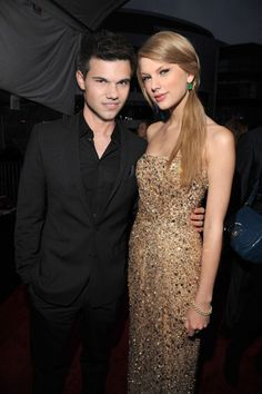 Taylor Swift & Taylor Lautner <3 they were so cute together (LOVE HER DRESS (: )
