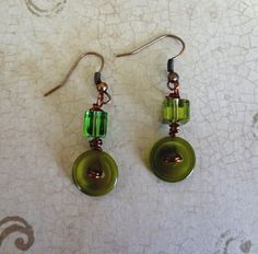 Olive Green and Copper Button Earrings  Repurposed Buttons   Button Jewelry. $7.50, via Etsy.