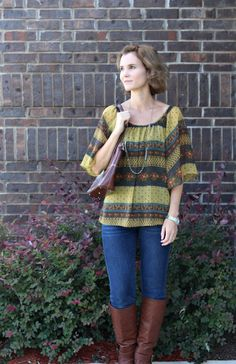 Simple style: Boho top, jeans and boots.