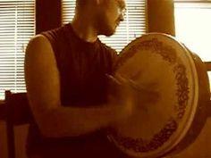 Man Playing Bodhran (Irish Drum)