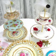 tea, cake and cupcake stands in 3 tiers of vintage European china by High Tea for Alice by highteaforalice, via Flickr