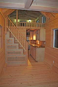 A tiny house on wheels with two lofts and stairs in Felton, California. Designed…