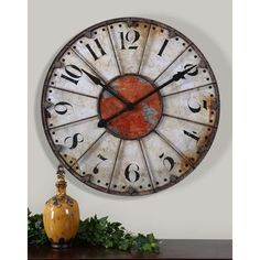 "Featuring a crackled ivory face with rust red accents and rustic bronze metal details, the Ellsworth 29"" wall clock is a must-have item. It would be perfect in a living room, dining room or kitchen. Be sure to check out RC Willey's large selection of clocks!  #Decorating #HomeDecor #Accessories #Style #InteriorDesign #InteriorInspo #"