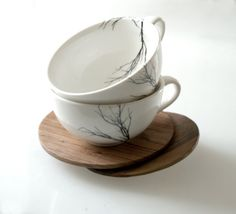 tree cups with wooden saucers