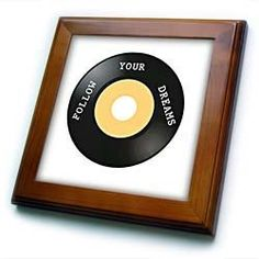 """45 Record With Follow Your Dreams Written On It - 8x8 Framed Tile by 3dRose. $22.99. Cherry Finish. Inset high gloss 6"""" x 6"""" ceramic tile.. Solid wood frame. Dimensions: 8"""" H x 8"""" W x 1/2"""" D. Keyhole in the back of frame allows for easy hanging.. 45 Record With Follow Your Dreams Written On It Framed Tile is 8"""" x 8"""" with a 6"""" x 6"""" high gloss inset ceramic tile, surrounded by a solid wood frame with pre-drilled keyhole for easy wall mounting."""
