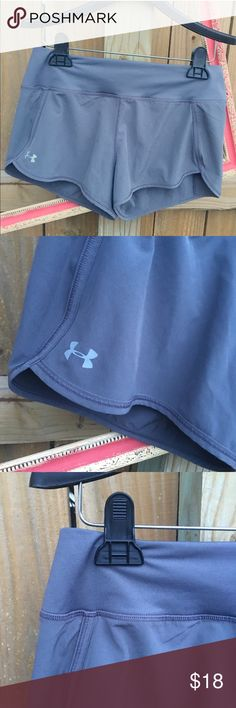 Under Armour running shorts sz: Small Worn twice, like new condition, gray Under Armour Heat Gear running shorts sz: Small. No flaws. Features built in bottoms underneath. Under Armour Shorts