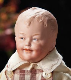 """German Bisque Smiling Character by Gebruder Heubach---pink tinted bisque, 11"""", Comments: Gebruder Heubach, circa 1912. Value Points: wonderfully expressive features, the model was more commonly used on all-bisque figurines and is rarely found as a doll."""
