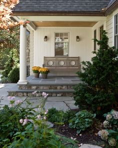 traditional porch design white siding exterior walls and pillars concrete floors custom wood bench with back a couple of wall lamps Outdoor Rooms, Outdoor Living, Outdoor Photos, Porches, Custom Capes, Traditional Porch, Home Porch, Front Entrances, Interior Exterior