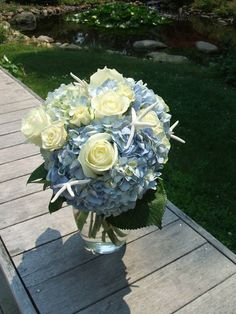 Blue flower girl basket daisies roses | Blue and white starfish bouquet with hydrangeas and roses
