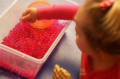 Gel balls/water beads--an instant hit with toddlers! Ridiculously cheap and great for sensory play.
