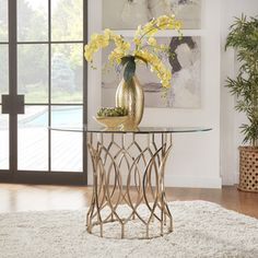 Shop for INSPIRE Q Davlin Round Glass Top Champagne Base Dining Table. Get free…