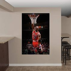 Show off your Michael Jordan fandom to the max with these Fathead Real Big Peel and Stick wall graphics! Featuring an action image of Michael Jordan, your wall will be the envy of all your sports friends!