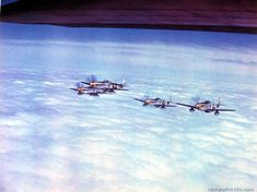 """A group of P-51 yellow-nosed mustang fighters is shown """"forming up"""" as they climb for altitude above a solid overcast. This picture was taken from the side of a B-17 flying fortress as they return from a mission over Germany. England, 1944"""