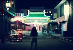 Shipwrecked -  photography by Anthony Samaniego  - July 23, 2013: I was drawn to this image as a result of the cool, neon colour scheme. By including the buildings on the sides of the street within the frame, the photographer positions the subject in between two leading lines, the buildings lining the pathway to the neon temple at the end of the street. The slight vignette also creates depth within the image. Shipwreck, Neon Colors, Pathways, Vignettes, Color Schemes, Fair Grounds, Explore, Cool Stuff, Street
