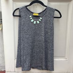 Lulu's Sleeveless Blue/Gray Top Dee Elle from Lulu's Fold Fashioned Sleeveless Blue/Gray Top. Size small. Loose fitting top for any occasion! Necklace not included. Worn once. Lulu's Tops