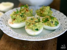8 hard boiled eggs, peeled, sliced in half and yolks removed     1 ripe avocado, pitted     1/2 small red onion, finely diced     1/2 -1 ...