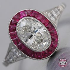 Art Deco Engagement Ring - in platinum with a wonderful one carat center stone... surrounded by rubies. ~beautiful~
