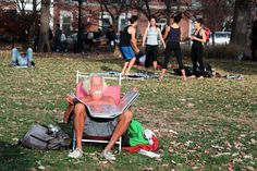 Unseasonably warm December weather has been bringing crowds to the parks, motivating many to get out and exercise, while some are wishing for the winter white others are enjoying time outdoors. Monte (no last name or age given) work his tan at the Washington Square Park in downtown Manhattan.(Photo by: Luiz C. Ribeiro)