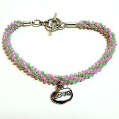 Love bracelets, this is beautiful!!!  Pink and Green Beaded Kumihimo Bracelet with Love Charm, Handmade