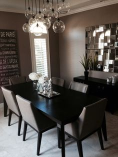 Modern Dinning Room. Table and chairs West elm. Chandelier and mirrors CB2.