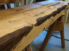 The edges of the hollow beams are stained dark to simulate the sapwood. This treatment also unifies the corners and makes the individual boards look like one beam.