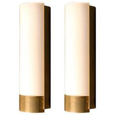 Pair of 1960s Sconces by Maison Lunel   From a unique collection of antique and modern wall lights and sconces at https://www.1stdibs.com/furniture/lighting/sconces-wall-lights/
