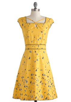 Seen in St. Augustine Dress | Mod Retro Vintage Dresses | ModCloth.com ~ A yellow dress that is romantic is not always an easy find, but the adorable sailboats that dot this dress just have that sweet take-me-away whimsy.  I would wear this up and down the streets and boardwalks of Nantucket!