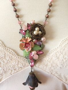 Nest in the Thicket...Here is an upcycled necklace handmade by me that is OOAK. It is made from a repurposed hinge, hand-wired bird nest, and