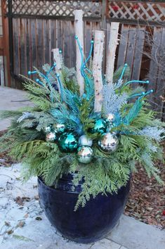 35 Festive outdoor holiday planter ideas to decorate your porch for Christmas - Home Decoration Christmas Urns, Silver Christmas Decorations, Coastal Christmas, Christmas Projects, Winter Christmas, Christmas Home, Christmas Wreaths, Christmas Ideas, Outdoor Christmas Planters