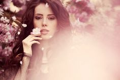 pink ethereal portrait of brunette girl with pink tree blossoms