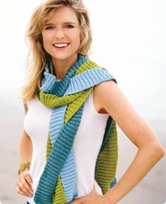 Courtney Thorne-Smith knits and is wearing a scarf she designed shown above.
