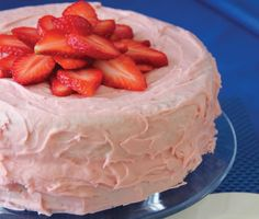 We re suckers for strawberries and this tasty dessert takes them to new flavor heights. Use frozen, unsweetened whole strawberries for the puree, as they re softer and easier to work. Use summer s best fresh strawberries to garnish the frosted gluten-free cake. You can add a touch of red food coloring to the batter to create a deeper rosy color. For best results, do not replace the eggs in this recipe.