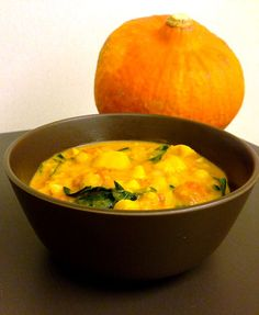 Creamy coconut-based sweet potato chickpea stew, with a bit of spice and a splash of fall festive orange. Healthy comfort food to indulge in all season. By Jess Davis