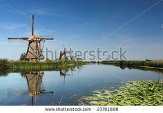 Reflection of five dutch windmills - stock photo