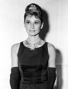Audrey Hepburn modeling Tiffany & Co.'s canary yellow diamond necklace for the 1961 film Breakfast at Tiffany's.