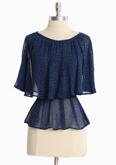 """Pebble Lake Tiered Top 36.99 at shopruche.com. We adore this delicate blue chiffon top with a black polka dot print. Finished with flowing tiers, a waist-defining sash, and subtle gathers for an ethereal silhouette. Semi sheer.  100% Polyester, Made in USA, 23"""" length from top of shoulder"""