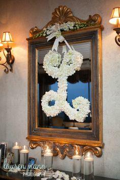 Fresh Affairs: floral initial wreath; candles