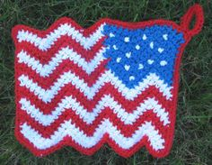 Free Crochet Pattern: Waving Flag Potholder   Express your patriotism with this potholder shaped like a waving flag! The potholder can be worked up quickly with just one layer, or you can make a double-thick version.