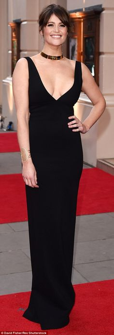 Oozing sex appeal: She worked the red carpet magic in a particularly bold black dress with...